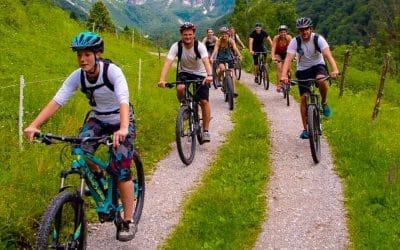 Bikers riding by Soča river