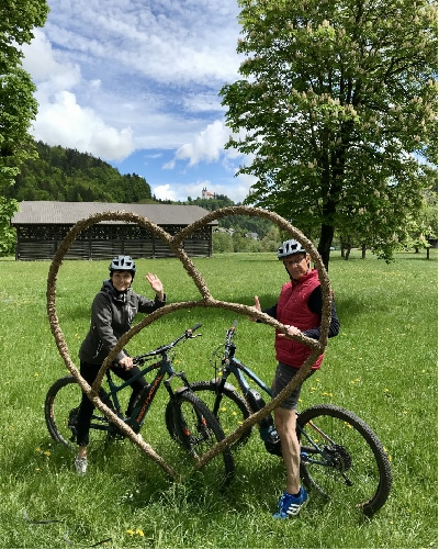 a couple exploring Slovenia on an e-bike