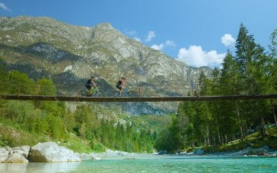 E-bike rent Slovenia - riding bikes over emerald river