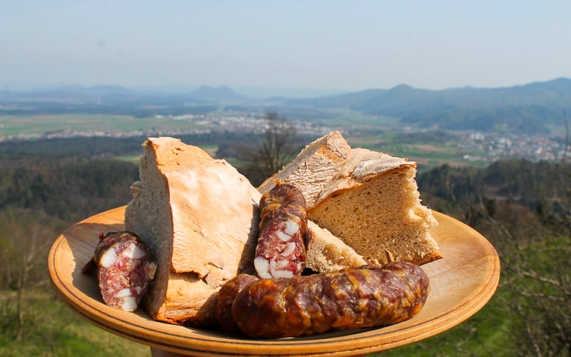 Slovenian food - home-made bread and smoked sausage