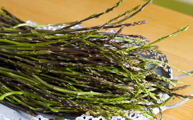 Slovenian food - beautiful green wild asparagus on a plate